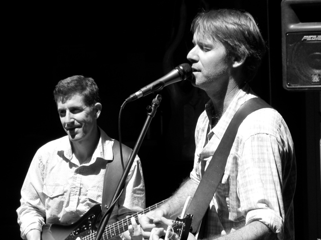 Chris (bassist) and Doug (singer/songwriter/acoustic guitar). Photo courtesy of El Con.