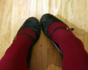 Black shoes with maroon tights.