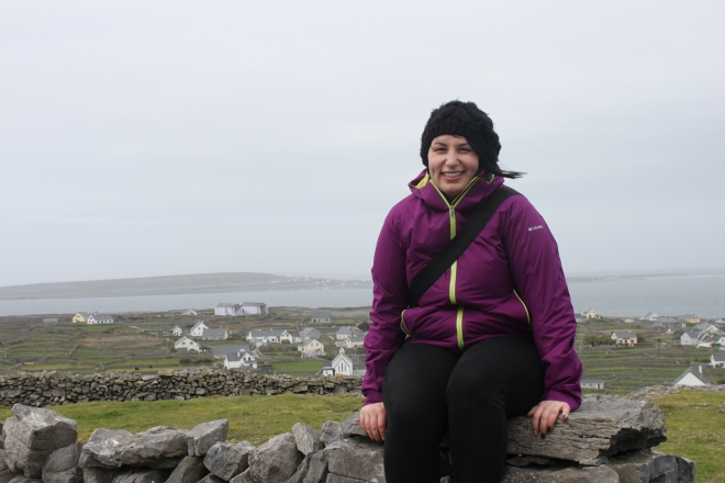 On a stone wall, overlooking the city and the ocean, on Inis Oírr.
